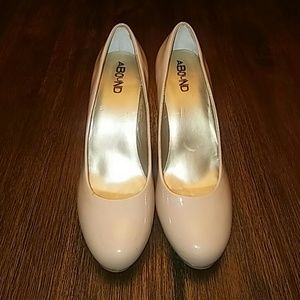 Nude Patent Leather Pumps